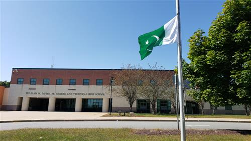 The flag of Pakistan in front of Davies.
