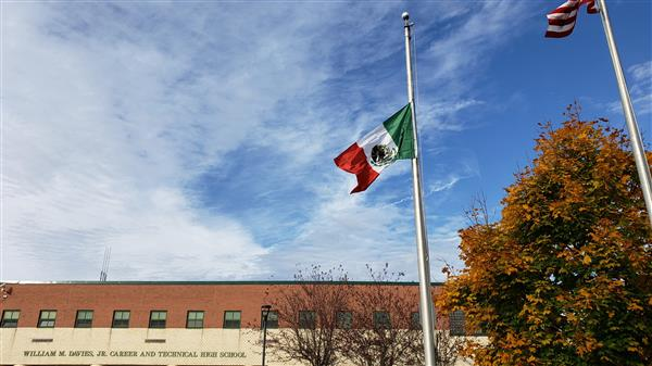 The flag of Mexico in front of Davies.