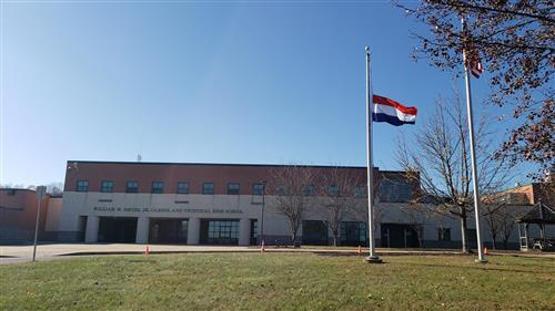 The Netherlands flag in front of Davies.