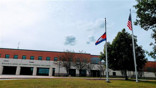 The Cambodian flag in front of Davies.