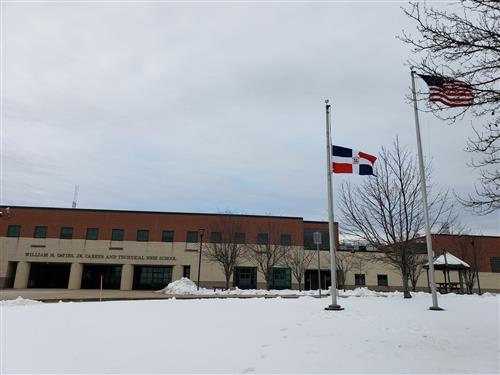 Dominican Republic flag in front of Davies High School.