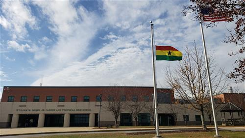 The flag of Ghana in front of Davies.