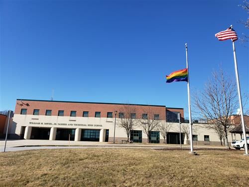 The rainbow flag in front of Davies high school.